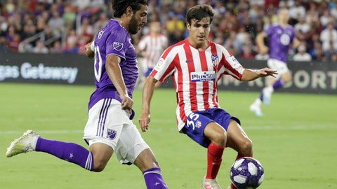 <p>               Los Angeles FC forward Carlos Vela, left, tries to get position for a shot against Atletico Madrid defender Manu Sanchez (35) during the first half of the MLS All-Star soccer match Wednesday, July 31, 2019, in Orlando, Fla. (AP Photo/John Raoux)             </p>