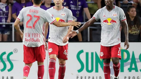 <p>               New York Red Bulls' Brian White, center, celebrates his goal against Orlando City with teammates Sean Davis (27) and Derrick Etienne Jr. (7) during the first half of an MLS soccer match, Sunday, July 21, 2019, in Orlando, Fla. (AP Photo/John Raoux)             </p>