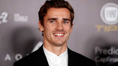 """<p>               FILE - In this Monday, Dec.3, 2018 file photo, Atletico Madrid's Antoine Griezmann arrives for the Golden Ball, """"Ballon d'Or"""" award ceremony at the Grand Palais in Paris, France. Barcelona says France forward Antoine Griezmann has agreed to join the Spanish champions after it paid his buyout clause to free him from rival Atletico Madrid. Barcelona says on Friday, July 12, 2019 that Griezmann will strengthen an attack led by Lionel Messi and Luis Suarez after signing a five-year contract. (AP Photo/Christophe Ena, file)             </p>"""