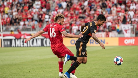<p>               Toronto FC midfielder Nick DeLeon (18) defends against Houston Dynamo defender A. J. DeLaGarza (20) during the first half of an MLS soccer game, Saturday, July 20, 2019 in Toronto. (Christopher Katsarov/The Canadian Press via AP)             </p>