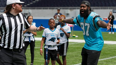 <p>               NFL player Mario Addison of the Carolina Panthers complains to the referee as he coaches a young team during the final tournament for the UK's NFL Flag Championship, featuring qualifying teams from around the country, at the Tottenham Hotspur Stadium in London, Wednesday, July 3, 2019. The new stadium will host its first two NFL London Games later this year when the Chicago Bears face the Oakland Raiders and the Carolina Panthers take on the Tampa Bay Buccaneers. (AP Photo/Frank Augstein)             </p>