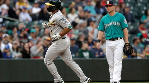 <p>               Oakland Athletics' Franklin Barreto (1) runs past Seattle Mariners third baseman Kyle Seager on Barreto's solo home run during the third inning of a baseball game Friday, July 5, 2019, in Seattle. (AP Photo/Elaine Thompson)             </p>