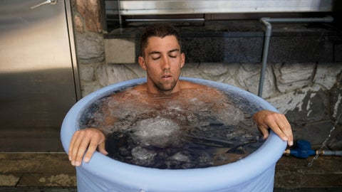 <p>               American beach volleyball player, Trevor Crabb, cools off in a bucket of ice water after competing during a test event at Shiokaze Park, a venue for beach volleyball at the Tokyo 2020 Olympics, Friday, July 26, 2019, in Tokyo. The heat is on for organizers of the 2020 Tokyo Olympics. Several days after marking one year to go before the opening ceremony, the notorious Tokyo heat kicked in just in time for a beach volleyball test event that gave organizers a chance to implement their heat countermeasures. (AP Photo/Jae C. Hong)             </p>