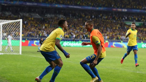 <p>               Brazil's Gabriel Jesus, left, celebrates with Richarlison his side's 2nd goal scored by teammate Roberto Firmino, right, during a Copa America semifinal soccer match against Argentina at the Mineirao stadium in Belo Horizonte, Brazil, Tuesday, July 2, 2019. (AP Photo/Ricardo Mazalan)             </p>