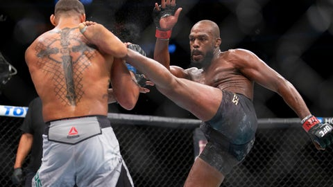 """<p>               File - In this July 6, 2019, file photo, Jon Jones, right, lands a kick on Thiago Santos during their light heavyweight mixed martial arts title bout at UFC 239 in Las Vegas. UFC light heavyweight champion Jon Jones is denying allegations that he assaulted a waitress in a New Mexico strip club. Denise White, a representative for Jones, said in a statement Monday, July 22, 2019, that he is confident he will be cleared of the """"baseless claim."""" (AP Photo/Eric Jamison, File)             </p>"""