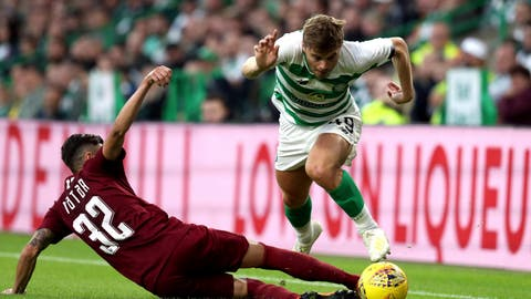 <p>               FK Sarajevo's Benjamin Tatar, left, and Celtic's James Forrest battle for the ball during the Champions League first qualifying round, second leg soccer match at Celtic Park, Glasgow, Scotland, Wednesday July 17, 2019. (Andrew Milligan/PA via AP)             </p>