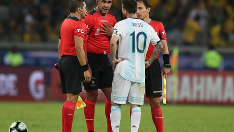 <p>               Argentina's Lionel Messi complains with referee Roddy Zambrano, center, during a Copa America semifinal soccer match at the Mineirao stadium in Belo Horizonte, Brazil, Tuesday, July 2, 2019. (AP Photo/Ricardo Mazalan)             </p>