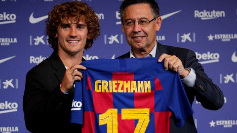 <p>               French forward Antoine Griezmann, left, holds up his new team shirt with FC Barcelona's President Josep Maria Bartomeu during his official presentation after signing for FC Barcelona in Barcelona, Spain, Sunday, July 14, 2019. (AP Photo/Emilio Morenatti)             </p>