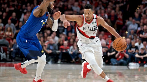 <p>               FILE - In this May 3, 2019, file photo, Portland Trail Blazers guard CJ McCollum, right, dribbles past Denver Nuggets guard Will Barton during the second half of Game 3 of an NBA basketball second-round playoff series in Portland, Ore. McCollum has agreed to a three-year contract extension with the Trail Blazers. The 27-year-old McCollum averaged 21.0 points last season, helping Portland make it to the Western Conference finals. The 6-foot-3 shooting guard, who was selected by the Trail Blazers with the 10th overall pick in the 2013 draft, has averaged at least 20.8 points over the last four years. (AP Photo/Craig Mitchelldyer, File)             </p>
