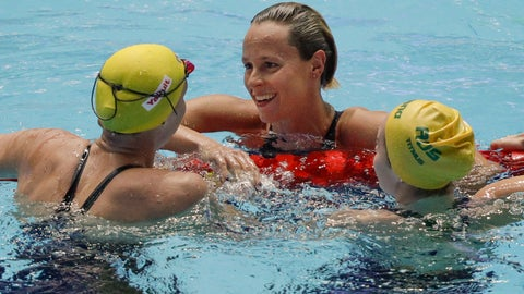 <p>               Italy's Federica Pellegrini, centre, is congratulated by Swden's Sarah Sjostrom, left, and Australia's Ariarne Titmus, right, after winning the women's 200m freestyle final at the World Swimming Championships in Gwangju, South Korea, Wednesday, July 24, 2019. (AP Photo/Mark Schiefelbein)             </p>