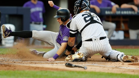 <p>               New York Yankees catcher Gary Sanchez (24) tags out Colorado Rockies' Garrett Hampson, who tried to score on a fly out by Charlie Blackmon during the second inning of a baseball game Friday, July 19, 2019, in New York. (AP Photo/Kathy Willens)             </p>