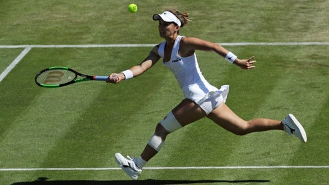 <p>               United States' Lauren Davis returns to Germany's Angelique Kerber in a Women's singles match during day four of the Wimbledon Tennis Championships in London, Thursday, July 4, 2019. (AP Photo/Ben Curtis)             </p>
