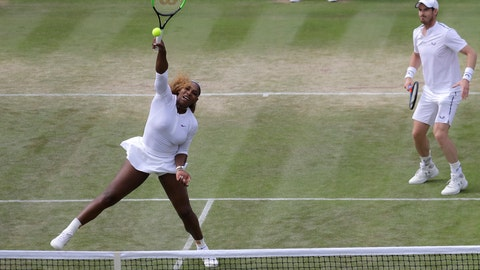 <p>               United States' Serena Williams and playing partner Britain's Andy Murray in action during a mixed doubles match against Unites States' Nicole Melichar and Brazil's Bruno Soares on day nine of the Wimbledon Tennis Championships in London, Wednesday, July 10, 2019. (AP Photo/Kirsty Wigglesworth)             </p>