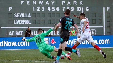 <p>               Liverpool goalie Andy Longergan (75) dives to make a save as Sevilla's Ocampos Lucas Ariel (25) tries to score past him and Liverpool's Andy Robertson (26) during the first half of a friendly soccer match at Fenway Park, Sunday, July 21, 2019, in Boston. (AP Photo/Mary Schwalm)             </p>