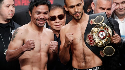 <p>               Manny Pacquiao, second from left, and Keith Thurman pose during a weigh-in Friday, July 19, 2019, in Las Vegas. The two are scheduled to fight in a welterweight championship boxing match Saturday in Las Vegas. (AP Photo/John Locher)             </p>