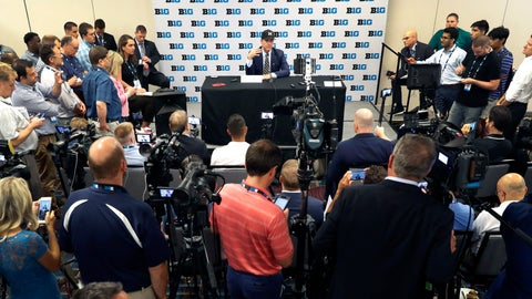 <p>               Michigan head coach Jim Harbaugh, back center, is surrounded by reporters and photographers during the Big Ten Conference NCAA college football media days Friday, July 19, 2019, in Chicago. (AP Photo/Charles Rex Arbogast)             </p>