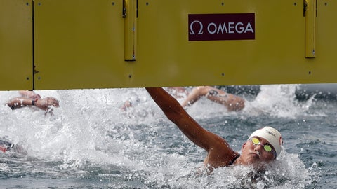 <p>               Xin Xin of China touches the timing board to win the women's 10km open water swim at the World Swimming Championships in Yeosu, South Korea, Sunday, July 14, 2019. (AP Photo/Mark Schiefelbein)             </p>