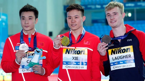 <p>               Gold medalist China's Xie Siyi, centre, stands with compatriot and silver medalist Cao Yuan and bronze medalist Britain's Jack Laugher, right, following the men's 3m springboard diving final at the World Swimming Championships in Gwangju, South Korea, Thursday, July 18, 2019. (AP Photo/Lee Jin-man)             </p>