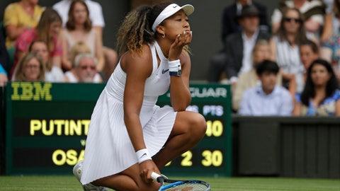 <p>               Japan's Naomi Osaka reacts as she plays Kazakstan's Yulia Putintseva in a Women's singles match during day one of the Wimbledon Tennis Championships in London, Monday, July 1, 2019. (AP Photo/Kirsty Wigglesworth)             </p>