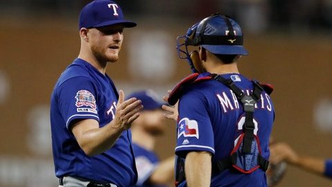 <p>               Texas Rangers relief pitcher Shelby Miller and catcher Jeff Mathis shake hands after the Rangers defeating the Detroit Tigers 5-3 in a baseball game, Tuesday, June 25, 2019, in Detroit. (AP Photo/Carlos Osorio)             </p>