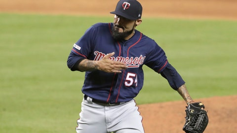 <p>               Minnesota Twins relief pitcher Sergio Romo puts his hand to his chest after Miami Marlins' Martin Prado struck out swinging during the eighth inning of a baseball game Tuesday, July 30, 2019, in Miami. The Twins won 2-1. (AP Photo/Lynne Sladky)             </p>