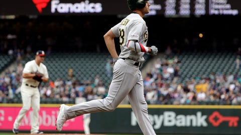 <p>               Oakland Athletics' Matt Olson, right, rounds the bases on his three-run home run as Seattle Mariners starting pitcher Matt Carasiti waits for the next batter in the first inning of a baseball game Sunday, July 7, 2019, in Seattle. (AP Photo/Elaine Thompson)             </p>
