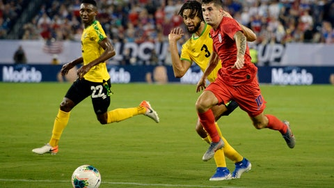 <p>               United States midfielder Christian Pulisic (10) moves the ball past Jamaica defender Michael Hector (3) during the first half of a CONCACAF Gold Cup semifinal soccer match Wednesday, July 3, 2019, in Nashville, Tenn. (AP Photo/Mark Zaleski)             </p>