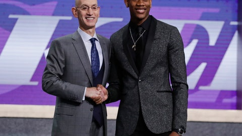 <p>               FILE - In this Thursday, June 20, 2019, file photo, Virginia's De'Andre Hunter, right, is greeted by NBA Commissioner Adam Silver after being selected with the fourth pick overall by the Los Angeles Lakers during the NBA basketball draft in New York. Hunter went No. 4 overall, taken by the Los Angeles Lakers. His rights had been traded twice, first to New Orleans as part of the Anthony Davis deal, then to Atlanta. But since neither of those trades could be closed before July 6, Hunter wore a Lakers cap on stage. Silver wants the hat game fixed. (AP Photo/Julio Cortez, File)             </p>