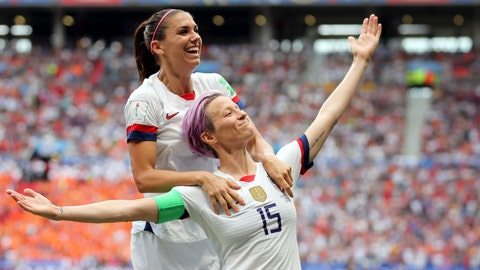 <p>               United States' Megan Rapinoe, right, celebrates after scoring the opening goal from the penalty spot during the Women's World Cup final soccer match between US and The Netherlands at the Stade de Lyon in Decines, outside Lyon, France, Sunday, July 7, 2019. (AP Photo/Francisco Seco)             </p>