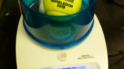 <p>               In this photo taken Friday June, 28, 2019, a Wimbledon 2019 tennis ball is weighed at the International Tennis Federation (ITF) lab in Roehampton, near Wimbledon south west London. Based for about 20 years in a three-room area on what used to be a pair of squash courts in Roehampton, the ITF tech lab is filled with more than $1 million worth of machines that help make sure rules are followed and parameters are met. (AP Photo/Alastair Grant)             </p>