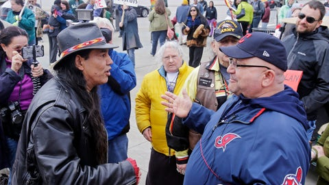 <p>               FILE - In this April 10, 2015, file photo, Philip Yenyo, left, executive director of the American Indians Movement for Ohio, talks with a Cleveland Indians fan before a baseball game against the Detroit Tigers in Cleveland. Chief Wahoo still plays here.  The Indians' fiercely debated logo and longtime mascot _ a shameful racist figure to some, source of civic joy to others _ is no longer on the field, but he hasn't completely gone away. He appears to be as visible as ever. (AP Photo/Mark Duncan, File)             </p>