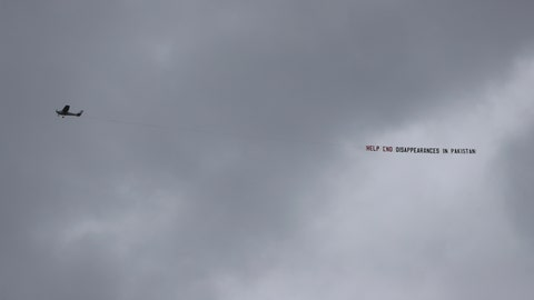 "<p>               An aircraft tows a banner that reads ""Help end disappearances in Pakistan"" as it flies over the venue of the Cricket World Cup semi-final match between England and Australia at Edgbaston in Birmingham, England, Thursday, July 11, 2019. (AP Photo/Aijaz Rahi)             </p>"