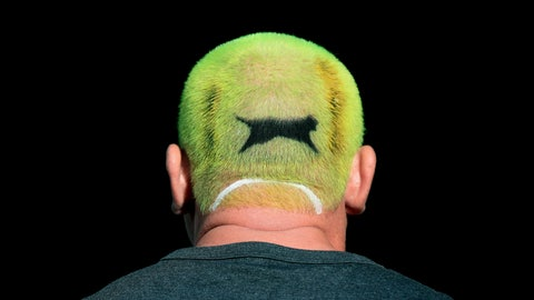 <p>               A tennis fan with his hair dyed the colour of a Slazenger ball on day one of the Wimbledon Tennis Championships in London, Monday July 1, 2019. (Mike Egerton/PA via AP)             </p>