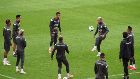 <p>               Peru's soccer players warm up during a practice session in Porto Alegre, Brazil, Monday, July 1, 2019. Peru will face Chile on July 3 in the semifinals for the Copa America. (AP Photo/Edison Vara)             </p>