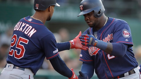 <p>               Minnesota Twins' Miguel Sano, right, celebrates with Byron Buxton (25) after hitting a two run home run off Oakland Athletics' Daniel Mengden in the second inning of a baseball game Tuesday, July 2, 2019, in Oakland, Calif. (AP Photo/Ben Margot)             </p>