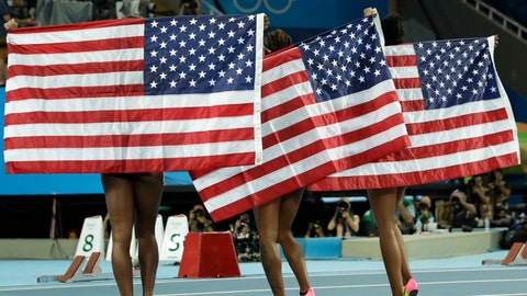 "<p>               FILE - In this Aug. 17, 2016, file photo, gold medal winner Brianna Rollins, center, silver medal winner Nia Ali, left, and bronze medal winner Kristi Castlin, all from the United States, pose with their country's flag after the 100-meter hurdles final during the athletics competitions of the 2016 Summer Olympics at the Olympic stadium in Rio de Janeiro, Brazil. If the Tokyo Olympics were opening today - actually they begin exactly a year from now - the United States would top the overall medal count, and the gold-medal count. That's the forecast released Tuesday, July 22, 2019, by Gracenote Sports, which bills itself as a ""sports and entertainment provider"" and supplies statistical analysis for sports league around the world. (AP Photo/Matt Dunham, File)             </p>"