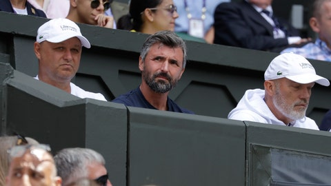 <p>               FILE - In this file photo dated Monday, July 1, 2019, Former Wimbledon champion Croatia's Goran Ivanisevic, centre, who watches from the players box as Serbia's Novak Djokovic plays Germany's Philip Kohlschreiber in a Men's singles match a the Wimbledon Tennis Championships in London. Croatia fought a bloody war for independence from Serb-led Yugoslavia in the 1990s, and Novak Djokovic is facing criticism by nationalists in Serbia for inviting Goran Ivanisevic to his coaching team at Wimbledon. (AP Photo/Kirsty Wigglesworth, FILE)             </p>