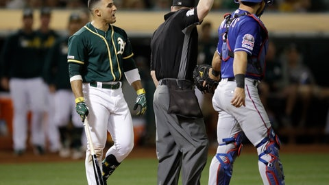 <p>               Oakland Athletics' Ramon Laureano, left, reacts after being hit by a pitch thrown by Texas Rangers' Rafael Montero in the eighth inning of a baseball game Saturday, July 27, 2019, in Oakland, Calif. At right is Rangers catcher Jeff Mathis. (AP Photo/Ben Margot)             </p>
