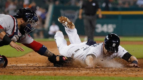 <p>               Detroit Tigers' Gordon Beckham beats the tag of Boston Red Sox catcher Sandy Leon to score during the sixth inning of a baseball game Saturday, July 6, 2019, in Detroit. (AP Photo/Carlos Osorio)             </p>