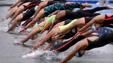 <p>               Swimmers leap into the water at the start of the 5km mixed relay open water swim at the World Swimming Championships in Yeosu, South Korea, Thursday, July 18, 2019. (AP Photo/Mark Schiefelbein)             </p>