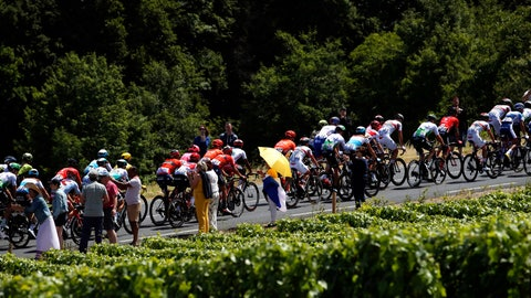 <p>               Spectators watch the pack riding during the fourth stage of the Tour de France cycling race over 214 kilometers (133 miles) with start in Reims and finish in Nancy, France, Tuesday, July 9, 2019. (AP Photo/Christophe Ena)             </p>