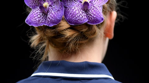 <p>               A ball girl has flowers in her hair during the women's singles final match between Romania's Simona Halep and United States' Serena Williams on day twelve of the Wimbledon Tennis Championships in London, Saturday, July 13, 2019.(Laurence Griffiths/Pool Photo via AP)             </p>