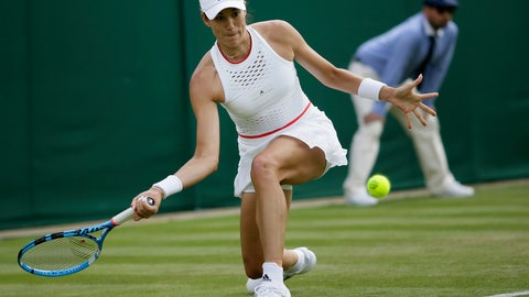 <p>               Spain's Garbine Muguruza returns to Brazil's Beatriz Haddad Maia in a Women's singles match during day two of the Wimbledon Tennis Championships in London, Tuesday, July 2, 2019. (AP Photo/Tim Ireland)             </p>