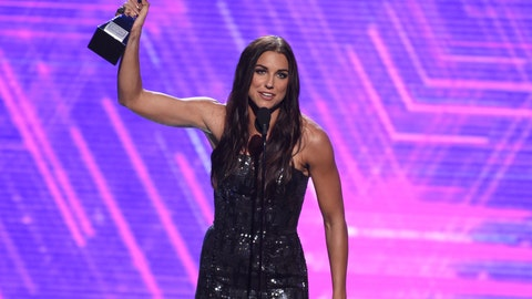 <p>               Alex Morgan, a member of the U.S women's national soccer team, accepts the award for best female athlete at the ESPY Awards on Wednesday, July 10, 2019, at the Microsoft Theater in Los Angeles. (Photo by Chris Pizzello/Invision/AP)             </p>