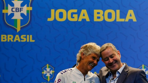 <p>               Pia Sundhage from Sweden, left, and Rogerio Caboclo, president of the Brazilian Football Confederation, touch their heads during her announcement as the coach of the Brazilian women's national soccer team, in Rio de Janeiro, Brazil, Tuesday, July 30, 2019. The 59-year-old Sundhage is the first foreigner to coach Brazil. (AP Photo/Leo Correa)             </p>
