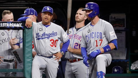 <p>               National League manager Dave Roberts (30), of the Los Angeles Dodgers, talks with National League Kris Bryant (17), of the Chicago Cubs, during the fifth inning of the MLB baseball All-Star Game against the American League, Tuesday, July 9, 2019, in Cleveland. (AP Photo/John Minchillo)             </p>