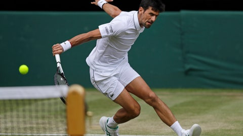 <p>               Serbia's Novak Djokovic returns to Spain's Roberto Bautista Agut in a Men's singles semifinal match on day eleven of the Wimbledon Tennis Championships in London, Friday, July 12, 2019. (AP Photo/Kirsty Wigglesworth)             </p>