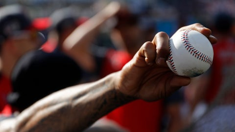<p>               Marcus Stroman, of the Toronto Blue Jays, holds a baseball as the American League players take batting practice before the MLB baseball All-Star Game, Tuesday, July 9, 2019, in Cleveland. (AP Photo/John Minchillo)             </p>