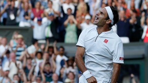 <p>               Switzerland's Roger Federer celebrates after beating Spain's Rafael Nadal in a Men's singles semifinal match on day eleven of the Wimbledon Tennis Championships in London, Friday, July 12, 2019. (Adrian Dennis/Pool Photo via AP)             </p>