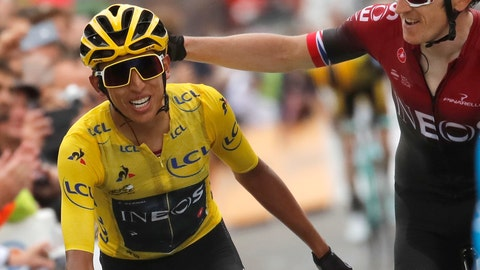 <p>               Britain's Geraint Thomas, right, congratulates Colombia's Egan Bernal wearing the overall leader's yellow jersey as they crosses the finish line of the twentieth stage of the Tour de France cycling race over 59,5 kilometers (36,97 miles) with start in Albertville and finish in Val Thorens, France, Saturday, July 27, 2019. (AP Photo/Christophe Ena)             </p>